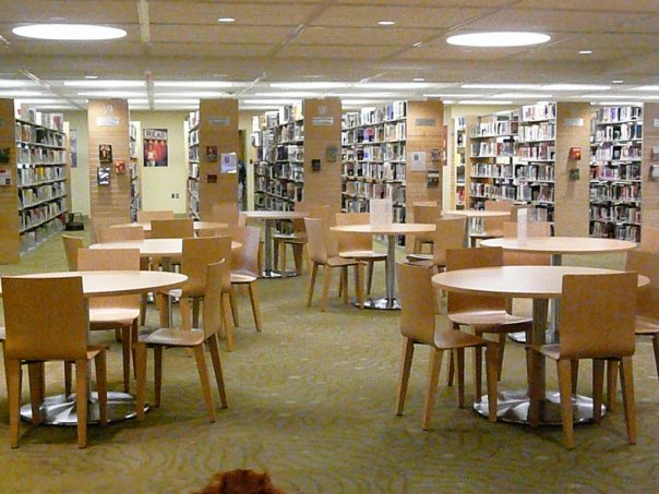 A picture of the Kirby Library showing tables and bookcases