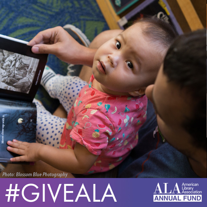 Baby reading with father at the library. #GiveALA, ALA Annual Fund