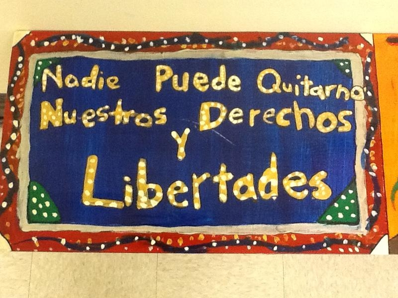 "Student-produced artwork reading ""Nobody Can Take Away Our Rights and Freedoms"" in Spanish"