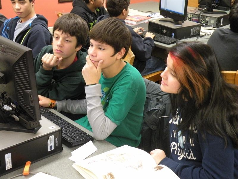 Students conducting computer research