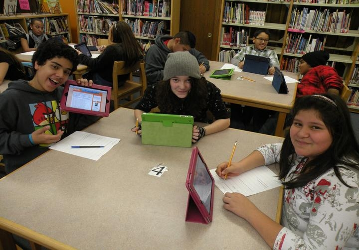 Inter-American Magnet School students conducting research for Who Are We program