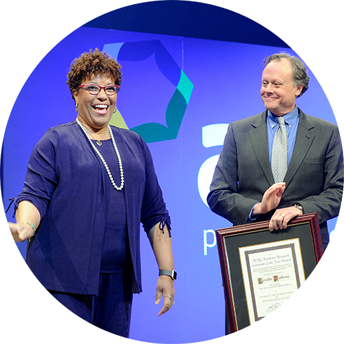 Image of Loretta Parham receiving an ACRL award, links to Achievement and Distinguished Service awards