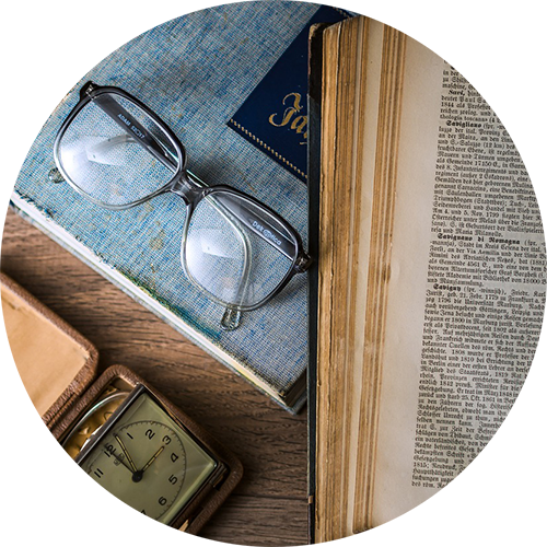Image of reading glasses on books, links to Research Awards and Grants