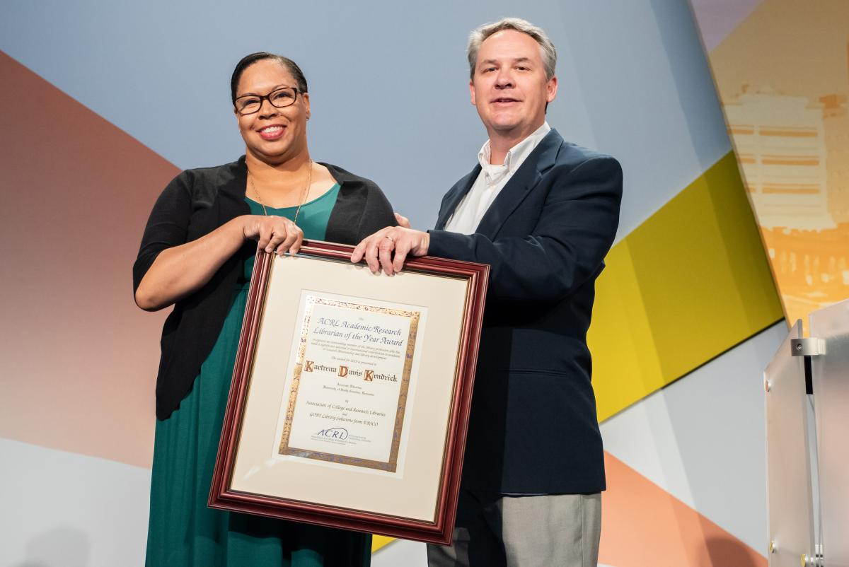 Image of Kaetrena Davis Kendrick accepting award on stage