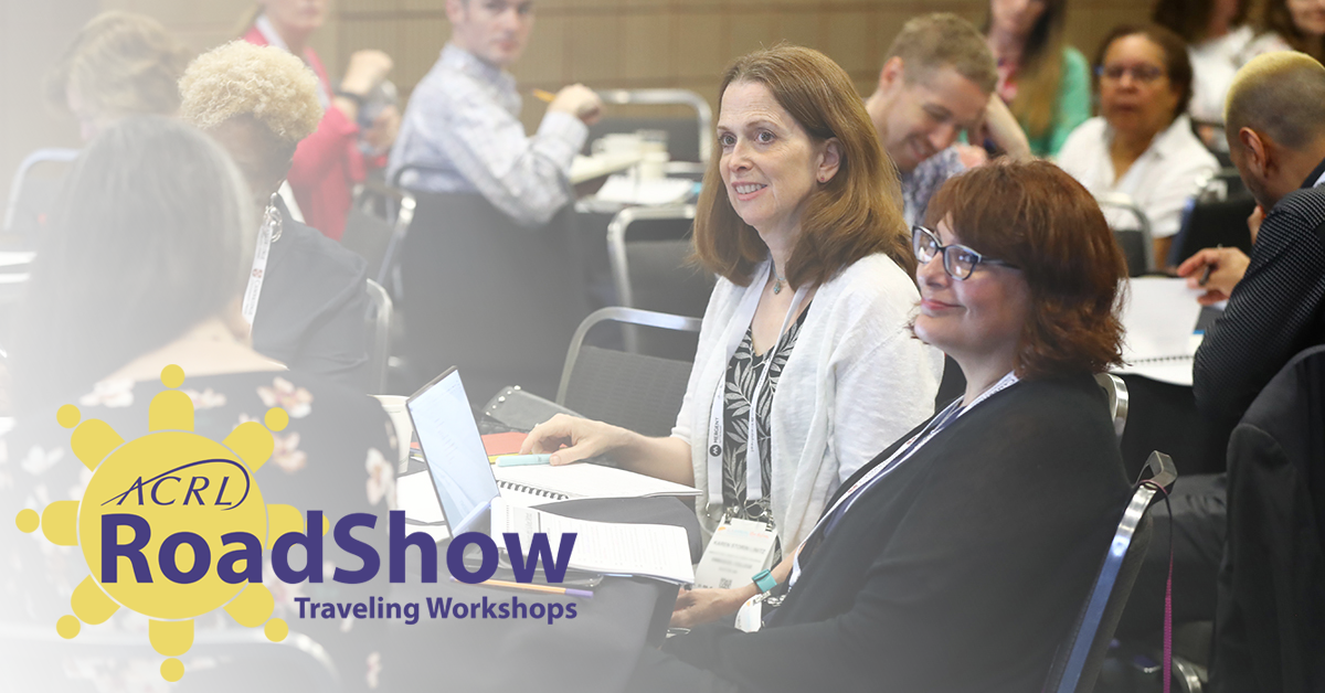 Photo of RoadShow attendees smiling at table with RoadShow logo overlayed