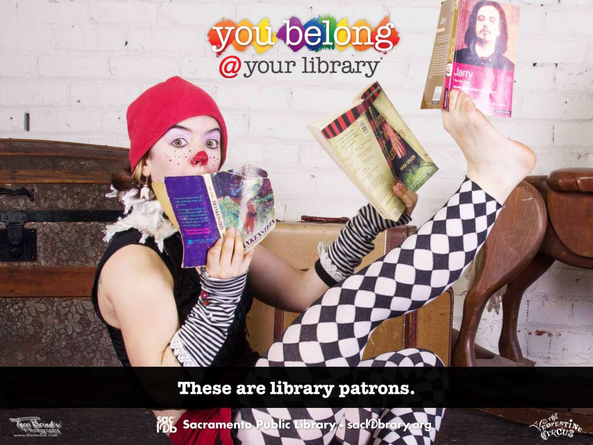 You belong @ your library These are library patrons (trapeze artist reading)