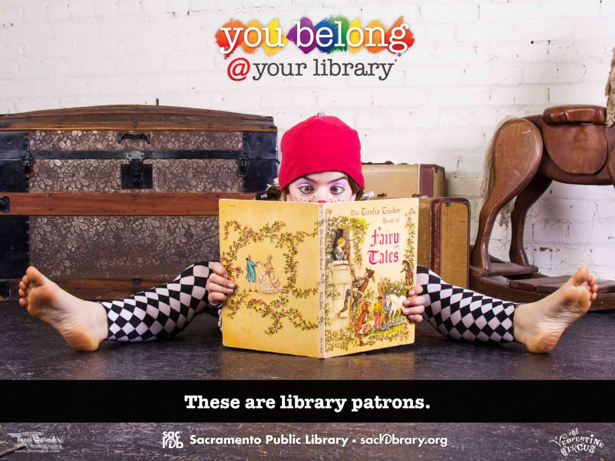 You belong @ your library These are library patrons (tcircus performer artist reading)