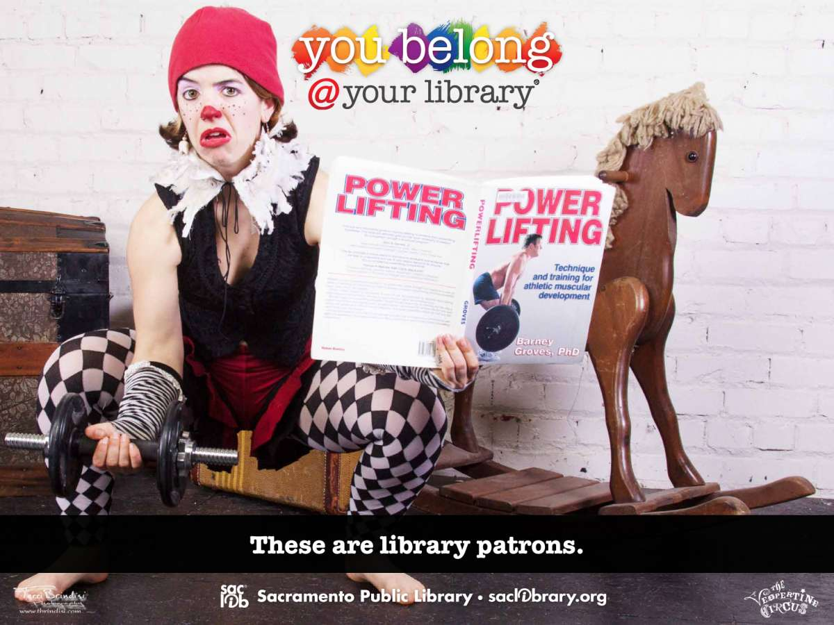 You belong @ your library These are library patrons (Female clown reading book on weightlifting)