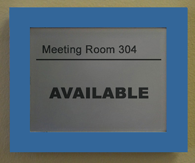 "Sign reading ""Meeting Room 304 Available"""