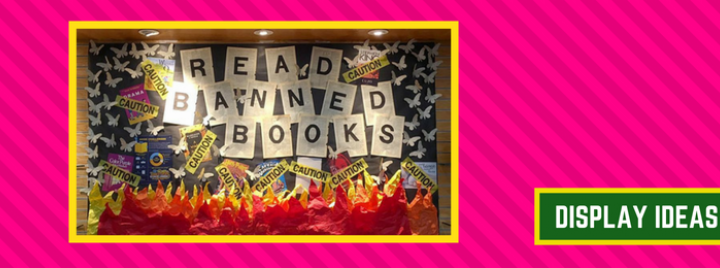 """A banned book display that states """"read banned books"""" with tissue paper fire and caution tape"""