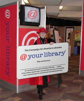 person holding huge library card