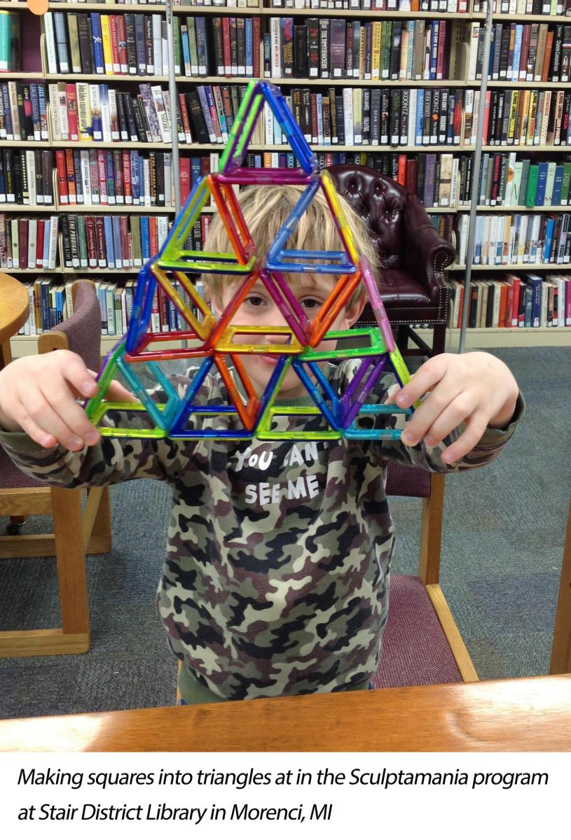 boy makes squares into triangles by creating a pyramid