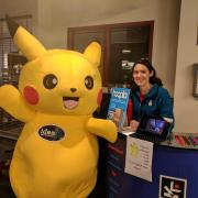 Angela Nolet with Pikachu character at King County Library System