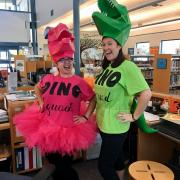 library workers dressed as dinosaurs at the library