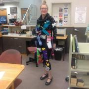 Jennifer Wood librarian dressed as black hole of laundry socks