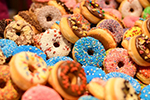 Assorted donuts in pink and blue with sprinkles