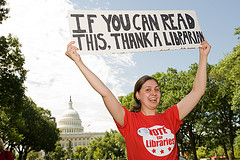librarian holding a sign