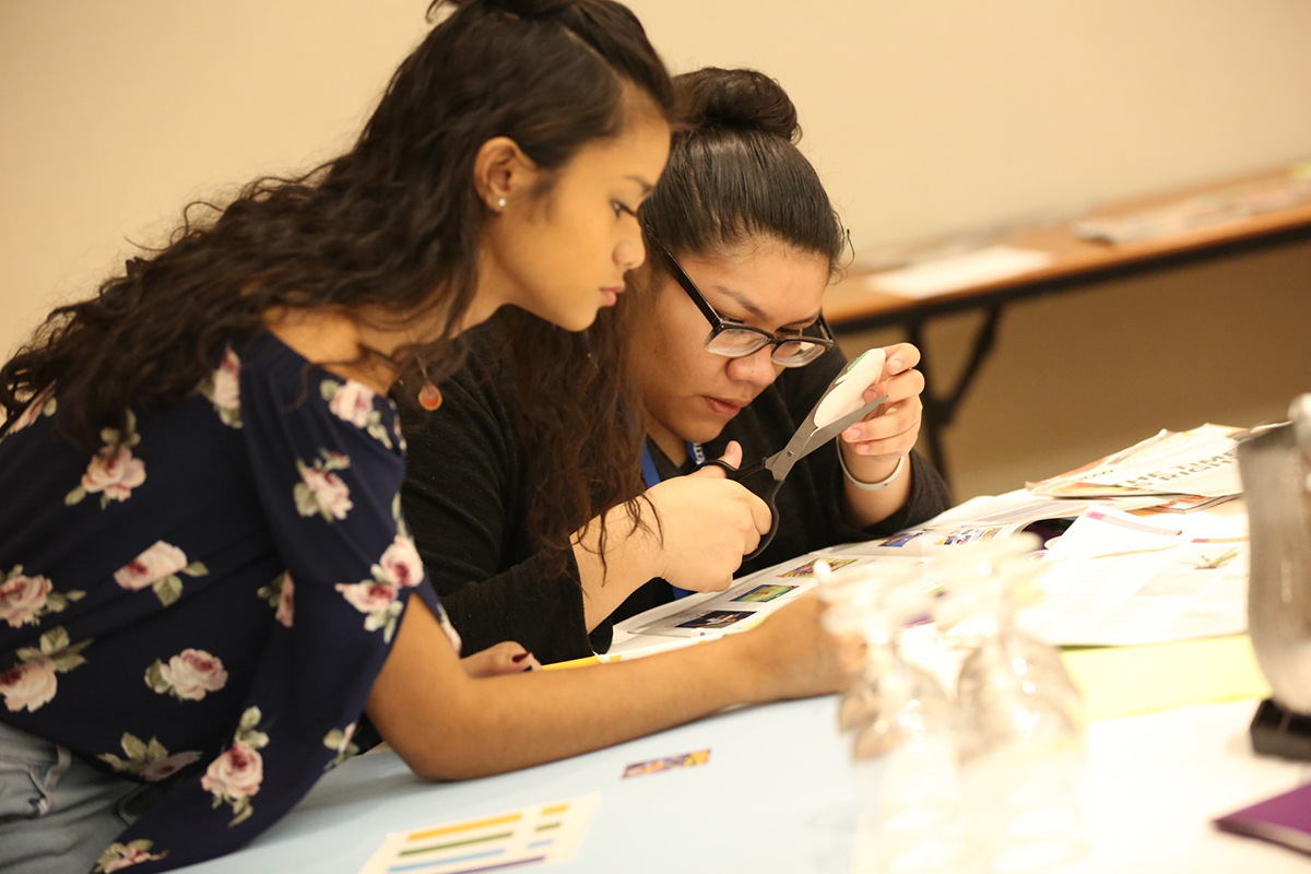 Nika Cunanan from Waipahu (Hawaii) Public Library (left) and Samantha Martinez from Anythink Libraries (Adams County, Colo.) work together on a project as part of PLA's Inclusive Internship Initiative.