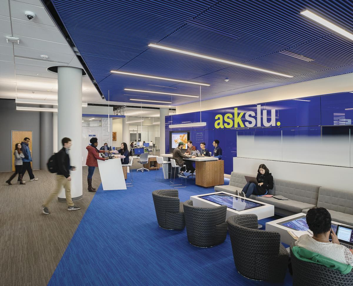 "The ""AskSLU"" concierge service at St. Louis University's Pius XII Memorial Library features walk-up information desks where patrons can receive technical support from both students and faculty."