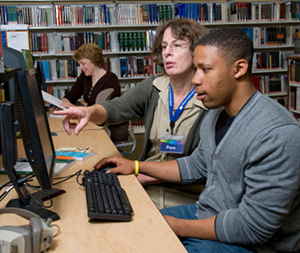 Job seeker at Pierce County Library system is aided by a library worker.