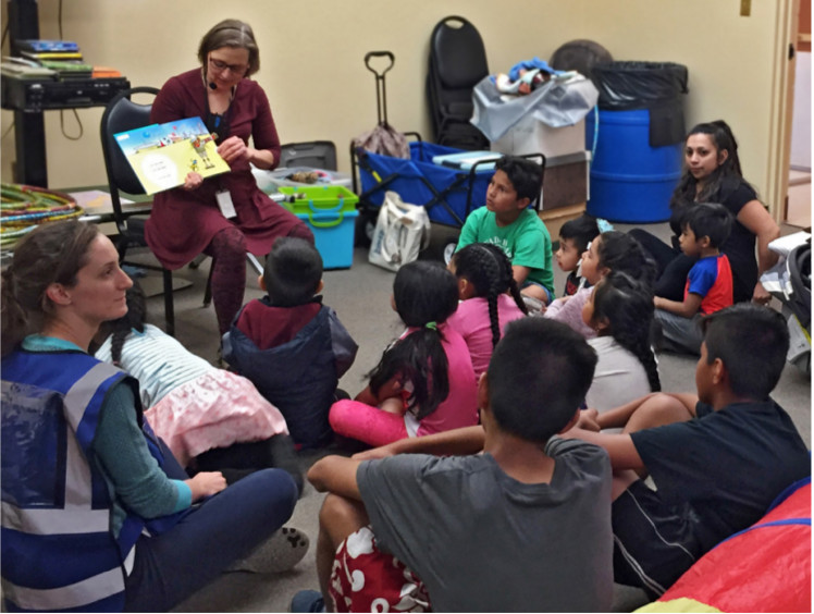 Margaret Stawowy, Children's Librarian, San Rafael Public Library, conducts a storytime at a North Bay fire evacuation center.
