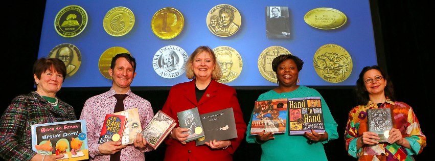 Left to Right: American Library Association (2012 – 2013) President Maureen Sullivan;  Young Adult Library Services Association President (2012- 2013) Jack Martin; Association for Library Service to Children President Carolyn Brodie; 2013 Chair of the Coretta Scott King Book Awards Committee Jonda McNair; and REFORMA President (2012- 2013) Denice Atkins