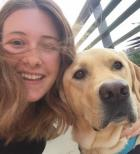 Photo of service animal with Broghan Sagers, recipient of the 2017 ALA Century Scholarship