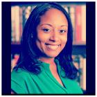 Photo of Shauntee Burns-Simpson in front of books