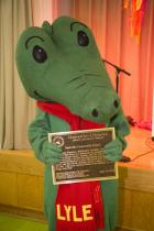 Lyle the Crocodile shows off his Literary Landmark plaque (photo credit: Mason Cash).