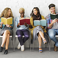 Image of diverse millennials sitting and reading books