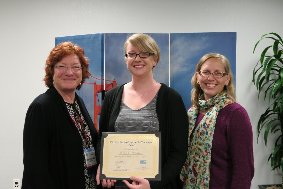 Dr. Samantha Hastings, Director of the School of Library and Information Science at USC, Taylor Atkinson, President  of the ALA Student Chapter at USC, and Michelle Demeter, NMRT Student Chapter of the Year Award committee chair in San Francisco.