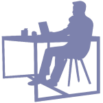 Silhouette of a person sitting at desk with a laptop