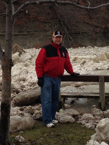 A memorial bench almost crushed by an ice jam in the Rocky River, Lakewood  OH