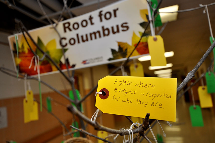 "The Root for Columbus tree and tag that states, ""A place where everyone is respected for who they are."""