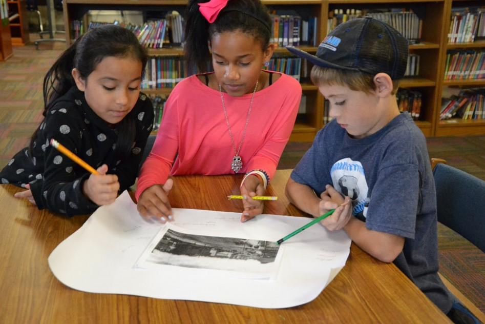 Students use images to make observations about town history