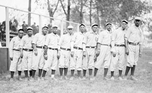 chicago union giants african american baseball team, standing in a line near a ballpark fence