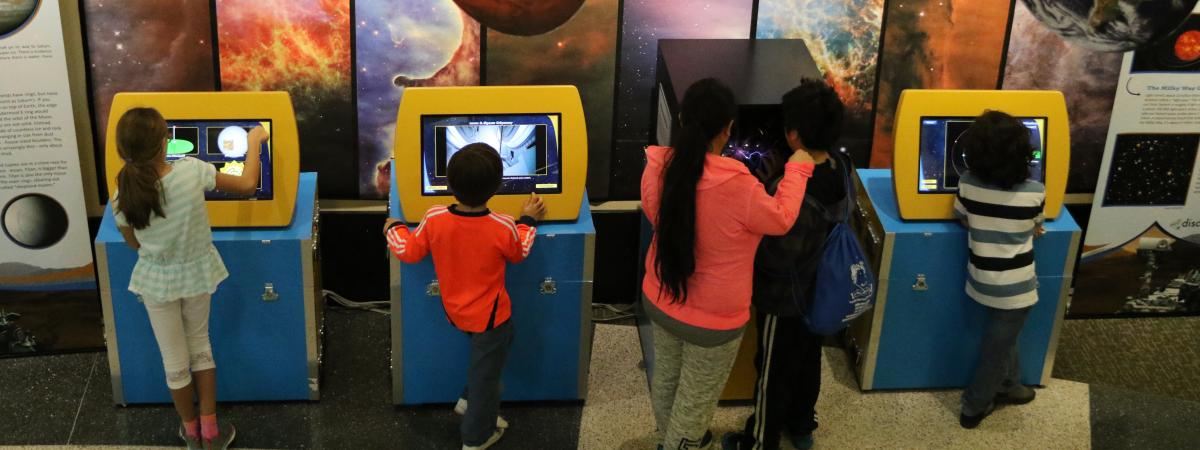Kids doing activities on a STEM exhibition