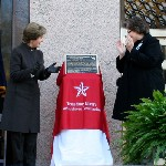 former first lady laura bush presents the literary landmark plaque to peggy d. rudd (photo by peggy lee oster, texas state library and archives commission).