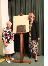 From left: ALTAFF past president Shirley Bruursema and Hackley Public Library Director Martha Ferriby unveil the Literary Landmark plaque.