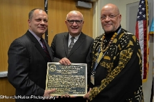 From left: Tom Gallante, CEO of the Queens Library; Rocco Staino of the Empire State Center for the Book, and Andrew Jackson, executive director of the Langston Hughes Community Library & Cultural Center at the Literary Landmark dedication for Langston Hughes.